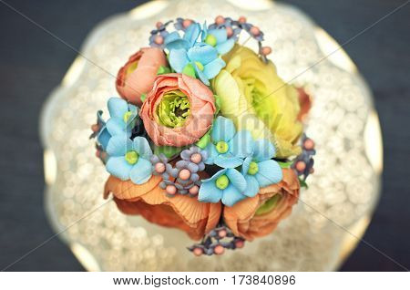 Top view of beautiful and tasty homemade cake with sugar paste edible colorful floral decorations.