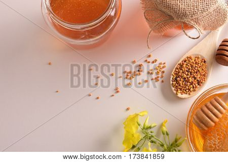 Containers With Honey Honeycomb And Pollen Bee Top