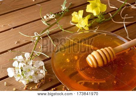 Jar Honey With Honeycomb On Wood Table Elevated View