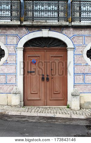 Typical portuguese door with azulejo tiles in Lisbon, Portugal