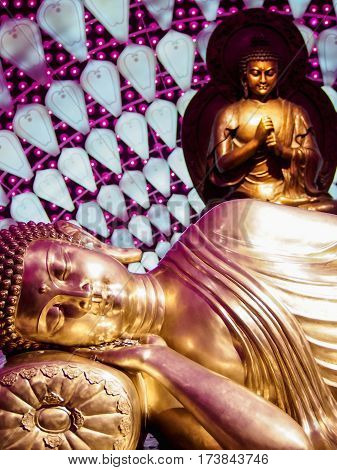 Gold Reclining Buddha With Neon Purple Lights
