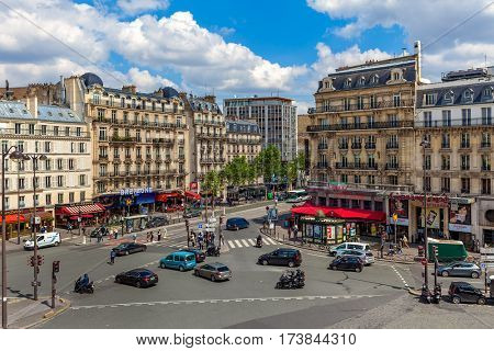 PARIS, FRANCE - MAY 25, 2016:  View of typical parisian building and boulevard du Montparnasse in Paris - capital and most populous city of France, one of the world's top tourist destinations.