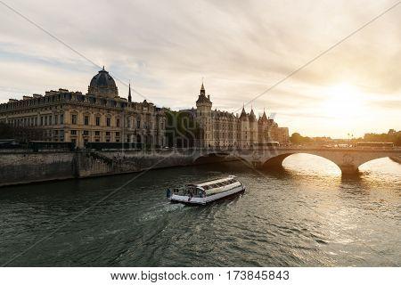 Boat tour on Seine river in Paris with sunset. Paris France