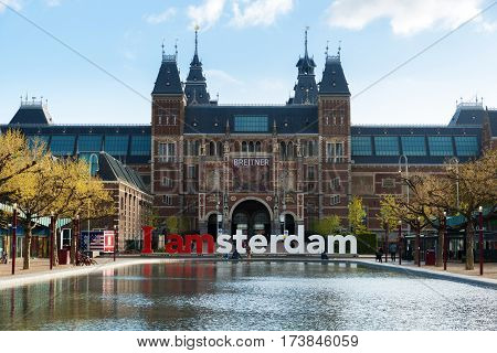 Amsterdam Netherlands - May 03 2016: The Rijksmuseum Amsterdam museum area with the words IAMSTERDAM in Amsterdam Netherlands.