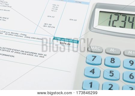 Utility Bill And Calculator Next To It