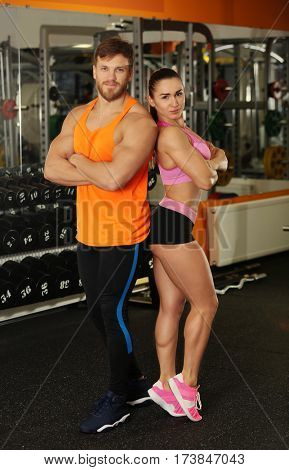 Sporty young couple in gym