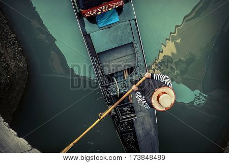 Venice. Gondoller and gondola in one of popular romantic place in the world on the street in Venice, Italy.