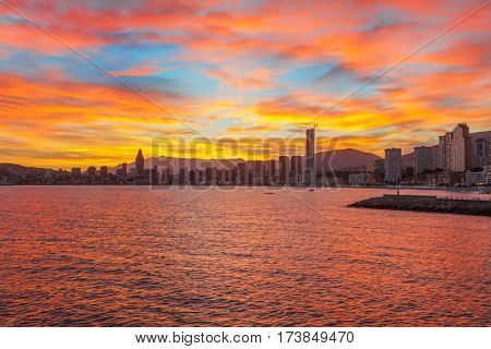 Benidorm city orangy red twilight scenery, Spain.