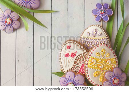 Homemade cookies with icing in the shape of an egg for Easter. Delicious Easter cookies on a white background. Colored glaze. Cookies for spring mood. Colored eggs on a white background.