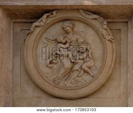 ROME, ITALY - SEPTEMBER 01: Charity Medallion on the Palazzo Montecitorio, seat of the Italian Chamber of Deputies in Rome, Italy on September 01, 2016.