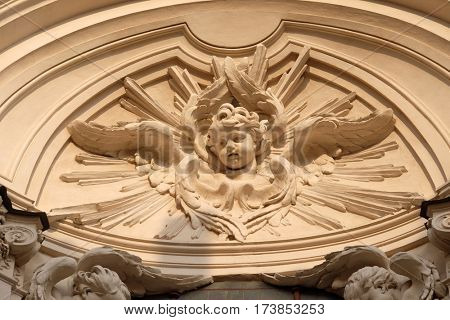 ROME, ITALY - SEPTEMBER 01: Stucco statue of Angel on the facade of Santissime Stimmate di San Francesco church, Rome, Italy on September 01, 2016.