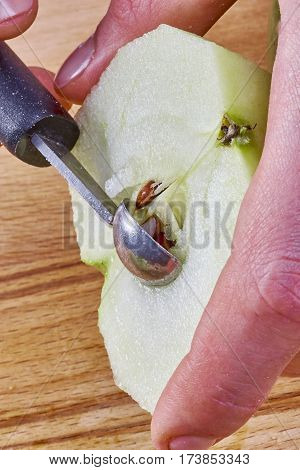 Cook cleans cut the apple for cooking cheesecake complete series of food recipes Food being prepared and cooked in a contemporary kitchen, with and without the chef