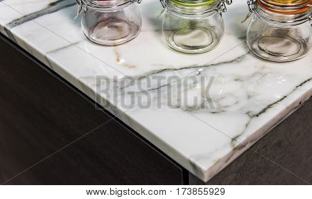 Marble. Stone marble. Kitchen counter top made of marble stone material. Stone worktop made of marble. Carrera Marble stone. Marbled stone surface.