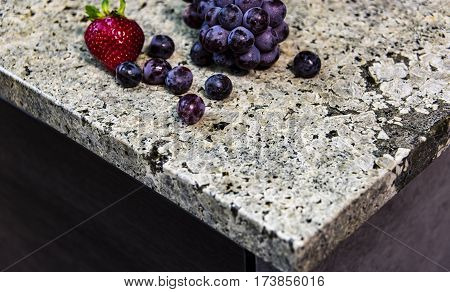 Granite counter top with fresh fruits on