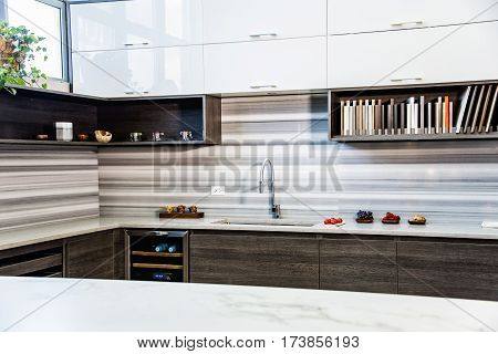 Kitchen in luxury home with maple wood cabinetry, kitchen design