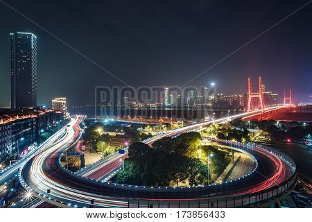 night view urban traffic with cityscape in Nanchang,China.