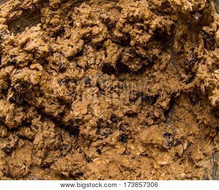 Fresh Batch of Oatmeal Rasiin Cookie Dough inside mixing bowl