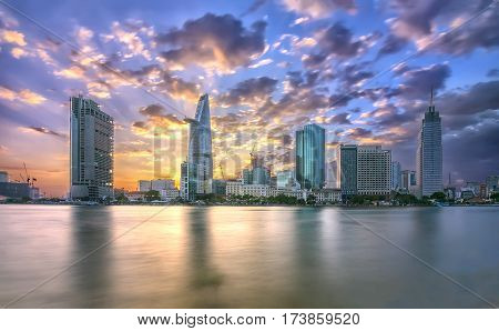 Ho Chi Minh City, Vietnam - February 14th, 2017: Beauty skyscrapers along river light smooth down urban development in Ho Chi Minh City, Vietnam