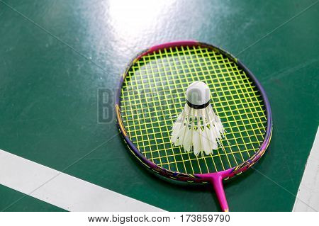 bad condition badminton ball with badminton racquet after hard trainning