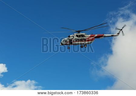 Kamchatka Peninsula, Russia - August 20, 2016: Sightseeing helicopter MI-8 for tourists in the cloudy sky