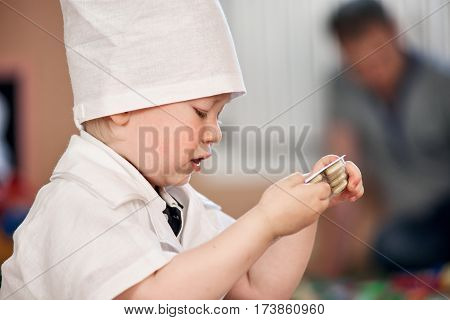Close up portrait of cute smiling boy playing doctor and holding pills