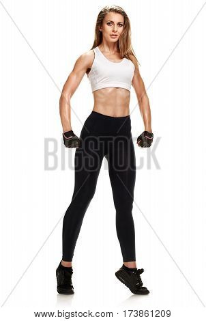 Full photo of fitness woman in sportswear demonstrating her strong body