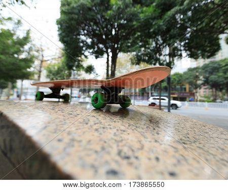closeup of skateboard at city skatepark waiting for riding