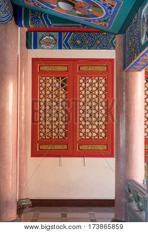 Traditional and architecture red window chinese style temple at Wat Mangkon Kamalawat or Wat Leng Noei Yi in NonthaburiThailand.