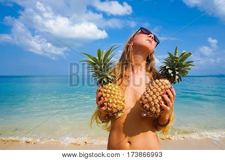 Portrait of Sexy Girl with Pineapples with Tropical Sea at Background