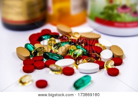 drug prescription for treatment medication in pharmacy, pills on counter on blurred pharmacy bottles, pharmaceutical medicament, heap of red orange white drugs and pills with medicine antibiotic in pharmacy on white counter.