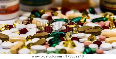 Pharmacy prescription for treatment medication. Pharmaceutical medicament, cure for health inside container. Pharmaceutical tablets, Heap of red orange white drugs and pills with medicine antibiotic on counter.