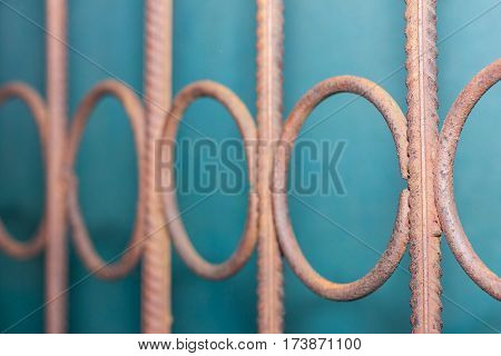 Twisted brown architecture forged fence in the garden. Concept: power security mesmerizing soothes
