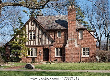Old Brick English Tudor House with Slate Roof