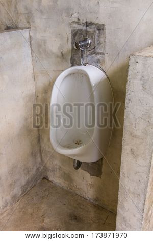 Urinal in toilet , men's bathroom object