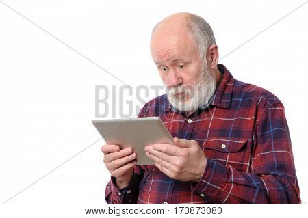 Senior bald and bearded white haired man astonished with something at screen of tablet computer, isolated on white background