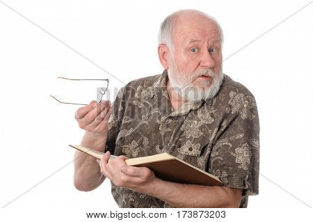 Handsome bald and bearded senior man distracted when reading a book, isolated on white background