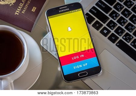 Chiang Mai,Thailand - March 1, 2017: Smartphone Samsung Galaxy S6 open apps snapchat application on the screen on the desk.