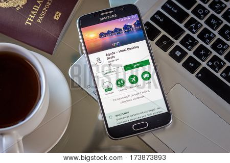 Chiang Mai,Thailand - March 1, 2017: Smartphone Samsung Galaxy S6 open apps agoda application on the screen on the desk.