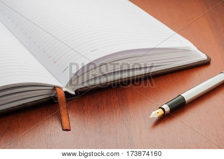 Open Notepad With A Pen On The Table.
