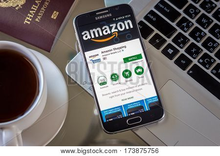 Chiang Mai,Thailand - March 1, 2017: Smartphone Samsung Galaxy S6 open apps amazon shopping online application on the screen on the desk.