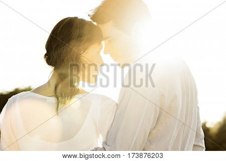 Rear view of romantic couple looking at each other during summer
