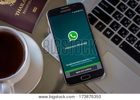 Chiang Mai,Thailand - March 1, 2017: Smartphone Samsung Galaxy S6 open apps whatsapp application on the screen on the desk.