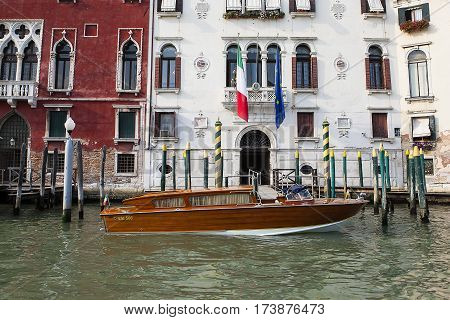VENICE ITALY - June 30 2016: View of water street in one of Venice Canals and old colorful buildings Venice Italy June 30 2016