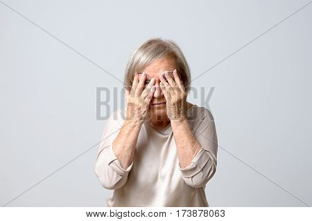 Woman Covering Eyes With Her Fingers