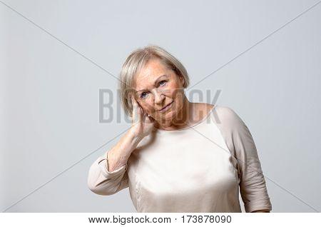 Woman Touching Her Ear.