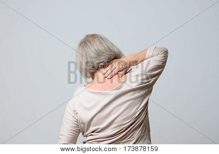 Senior Woman Touching Her Neck