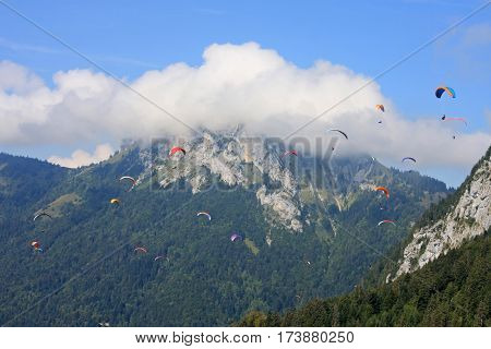 Paragliders flying wings in the French Alps