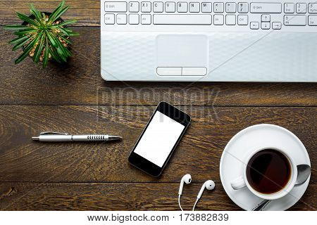 Top view notepaper pen mobile phone Laptop coffee on office desk background.