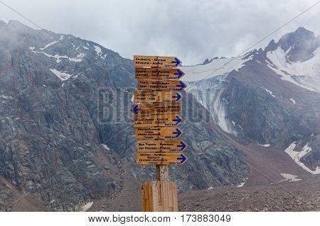 Pointer in Shymbulak. Wooden pointer in mountains of Kazakhstan.