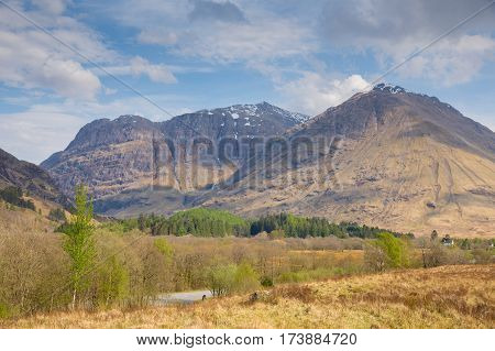 Snow topped mountains Glencoe Scotland UK famous tourist destination in Lochaber Scottish Highlands in spring
